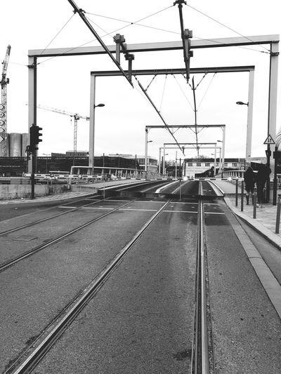 Railroad station platform against clear sky