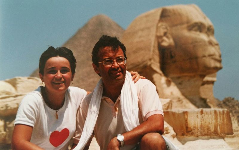 Smiling couple against the sphinx