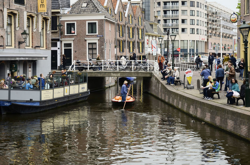 People on canal in city