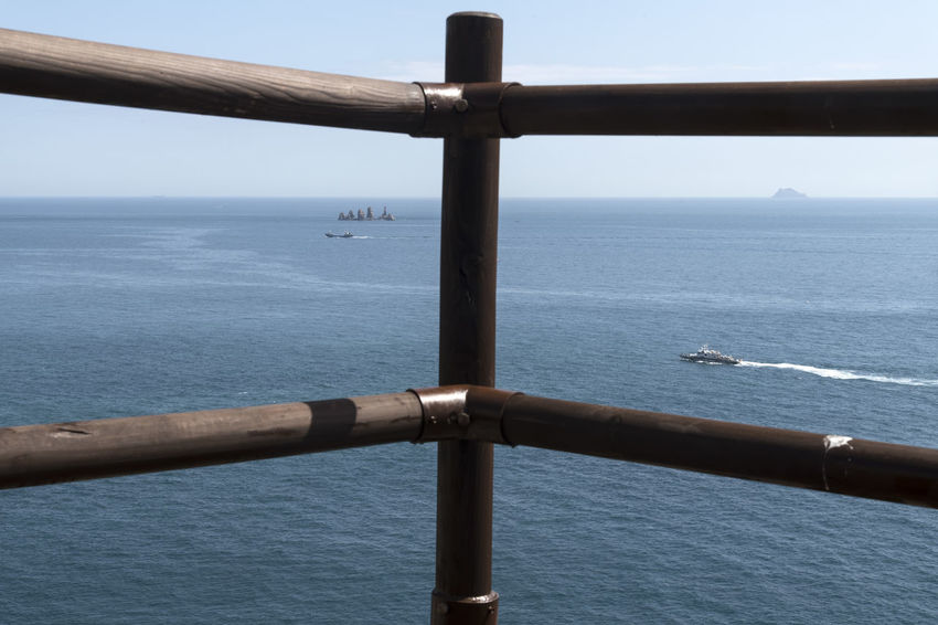 seaside view of Somaemuldo Island in the sea of Tongyeong, Gyeongnam, South Korea. Taken with Nikon d850. Nikon D3200 South Korea Tongyeong Tranquility Bright Day D850 Fence Guard Rail Horizon Over Sea Island Outdoor Outdoor Photography Outdoors Peaceful Day Peaceful Nature Seaside Ship Somaemuldo Tranquil Scene