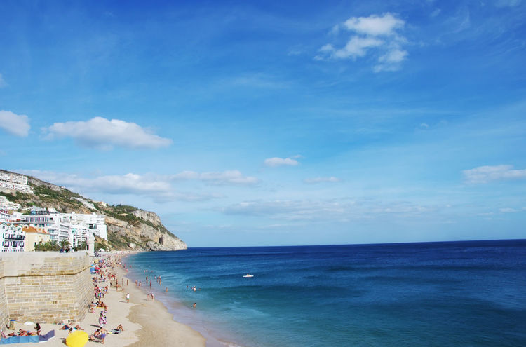 view on the coastal town of Sesimbra with beach in Portugal Architecture Beach Blue Building Exterior Cloud - Sky Horizon Horizon Over Water Outdoors Scenics - Nature Sea Sky Tranquil Scene Travel Water