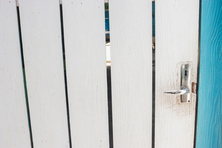 Wood - Material No People Pattern Day Closed White Color Close-up Built Structure Architecture Full Frame Backgrounds Door Entrance Safety Security Protection Plank Wood Lock Textured  Wood Paneling
