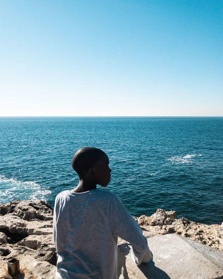 Boy in Blue Sea