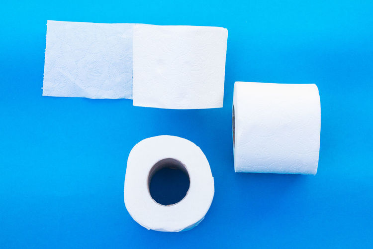 High angle view of papers against blue background