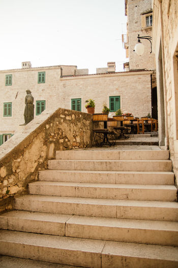 Outside Cafe on stairs Calm Romantic Sitting Outside Vacation Time Architecture Building Exterior Cafe City Dinner Location Direction Golden Hour Low Angle View Moving Up No People Railing Restaurant Sky Staircase Steps And Staircases The Way Forward