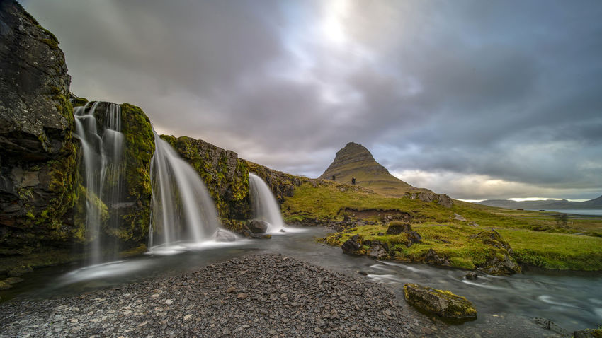 Kirkjufellsfoss waterfall is situated in Kirkjufellsa river and located near the proud mount Kirkjufell by Grundarfjordur town at the northern side of Snaefellsnes peninsula in West Iceland. Cloud - Sky Sky Water Scenics - Nature Beauty In Nature Nature Mountain Long Exposure Environment Non-urban Scene No People Rock Land Day Tranquil Scene Tranquility Solid Rock - Object Waterfall Outdoors Flowing Water Flowing Kirkjufellsfoss Beauty In Nature Landmark