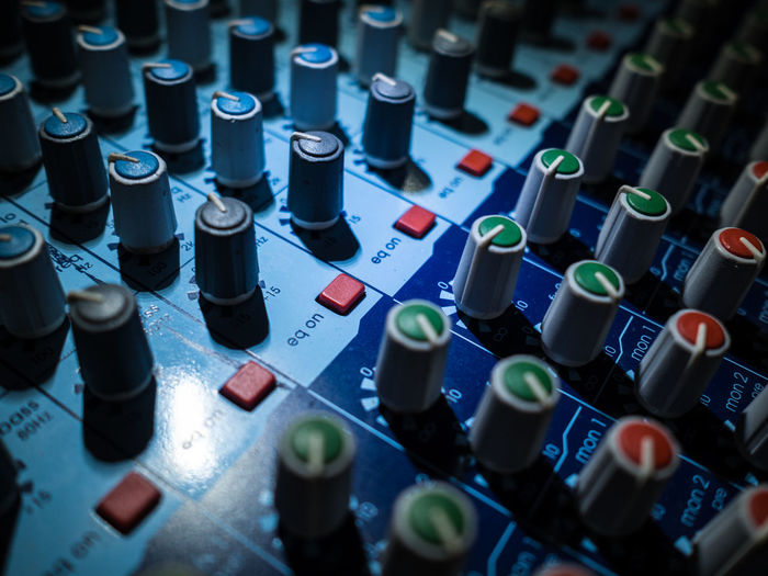 Full frame shot of sound mixer at recording studio