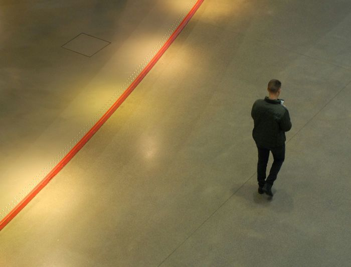 Full length rear view of a man walking at night