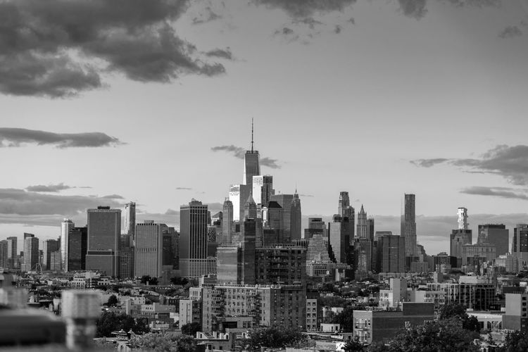 Manhattan New York City Skyline as viewed from Park Slope in Brooklyn in black and white. Brooklyn Manhattan New York City Park Slope Skyline Architecture Black And White Building Exterior Built Structure City Cityscape Cloud - Sky Day Modern No People One World Trade Center Outdoors Sky Skyscraper Sunset Tall Tall - High Tower Travel Destinations Urban Skyline