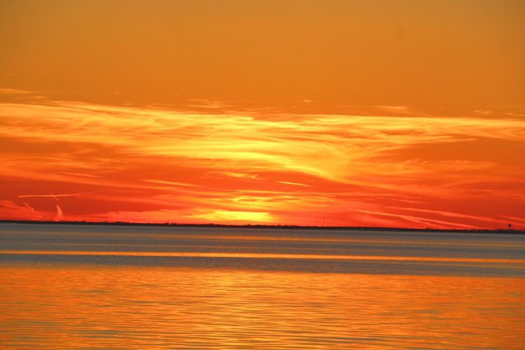 Sunset Orange Color Sea Scenics Tranquil Scene Water Tranquility Sky Dramatic Sky Horizon Over Water Outdoors No People Finding New Frontiers