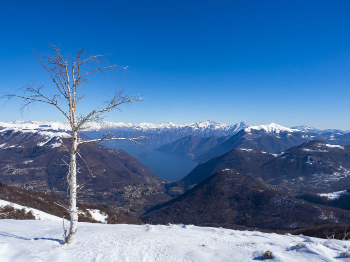 Winter landscape of lake como from valle intelvi alps