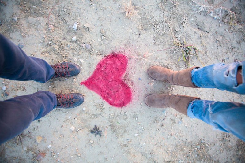 Low section of friends standing on heart