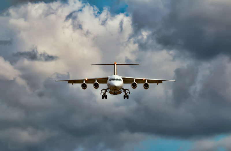 A small passenger aircraft approaching the airport Dramatic Sky Landing Air Vehicle Airplane Approaching Cloud - Sky Commercial Airplane Day Flying Landing Gear Low Angle View Mid-air Mode Of Transport No People Outdoors Sky Transportation The Week On EyeEm
