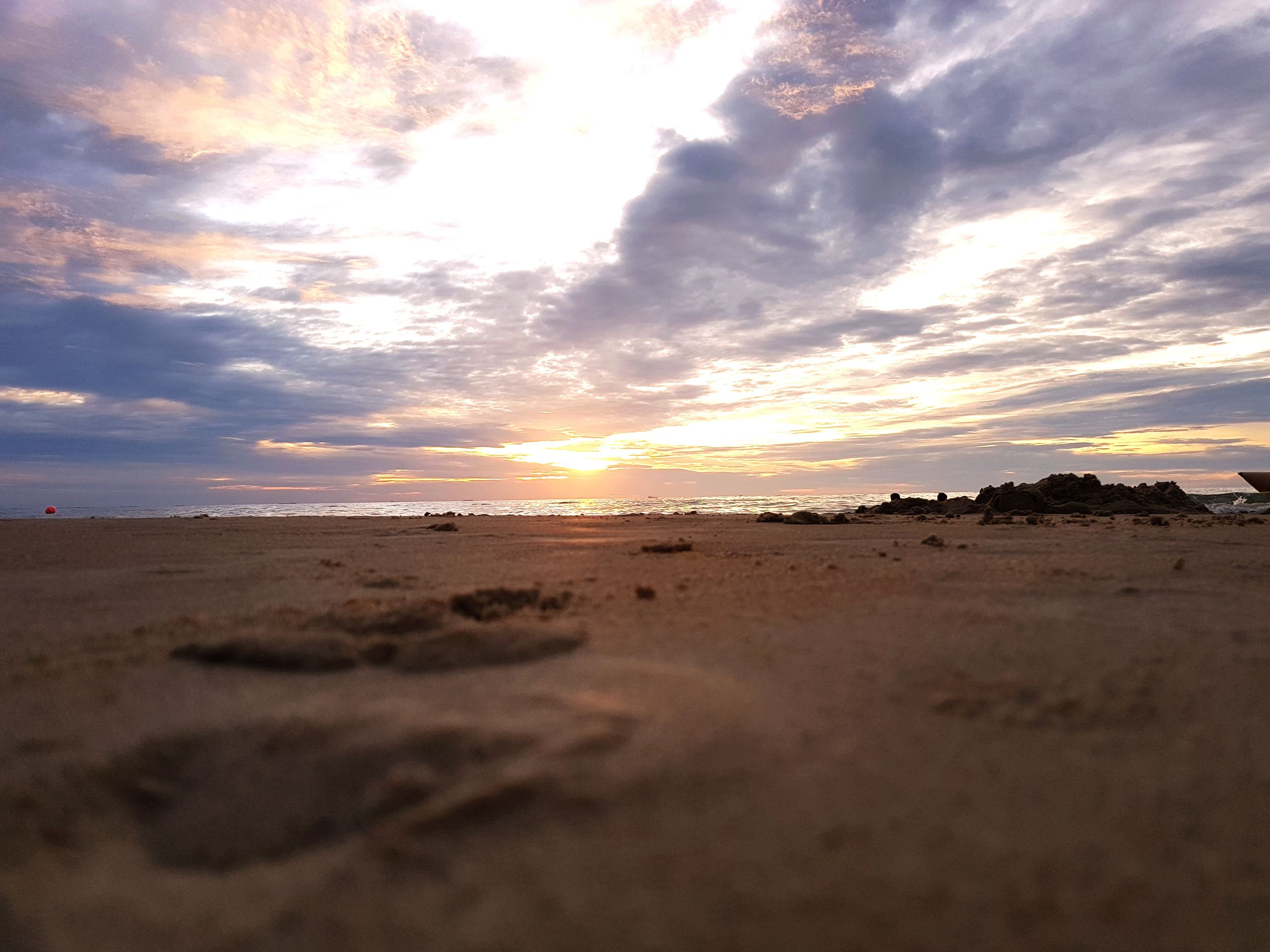 sand, beach, sky, nature, beauty in nature, sunset, sunlight, scenics, outdoors, cloud - sky, no people, tranquility, sun, sea, sand dune, day