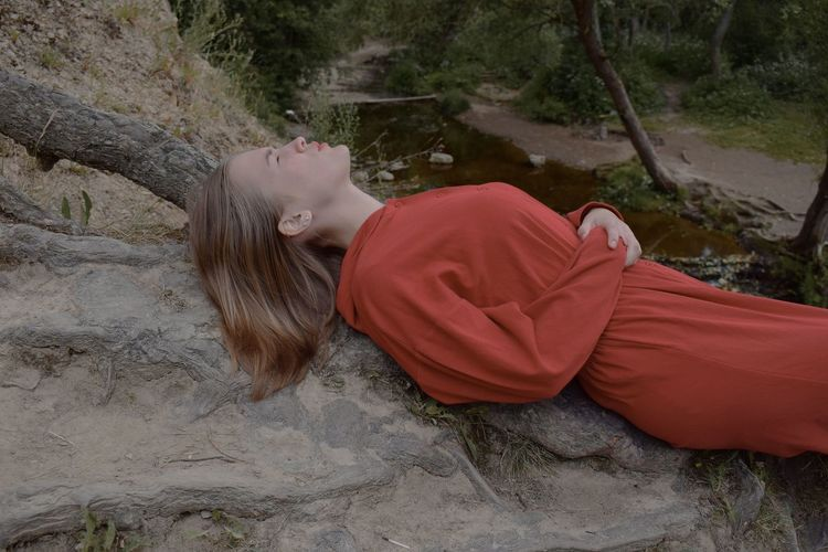 High angle view of woman lying down