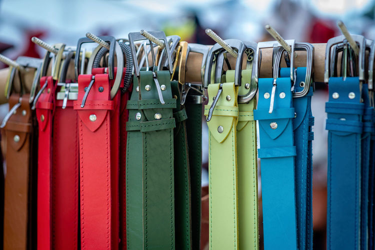 Close-up of colorful belts hanging for sale