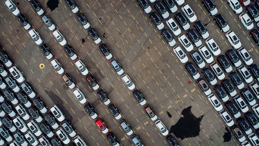 New cars parked in a row in the port of Gothenburg. Auto Background Business Car Dealer Delivery Distribution Dronephotography Export Front Group Import LINE Lines Lot Many Motor New Port Storage Trade Traffic Transportation Vehicle Volvo Fresh On Market 2017