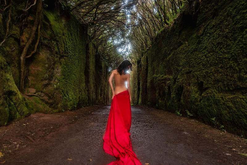 Shirtless Woman Wrapped In Red Fabric At Forest