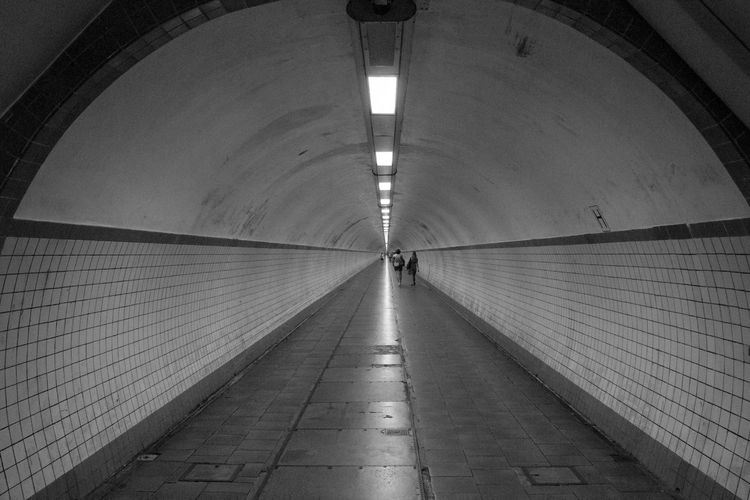 Sint-Annatunnel Arch Architecture Black And White Built Structure Ceiling Diminishing Perspective Direction Flooring Footpath Illuminated Incidental People Indoors  Light Light At The End Of The Tunnel Lighting Equipment Real People Rear View Subway The Way Forward Transportation Tunnel Underground Walkway Underpass Walking