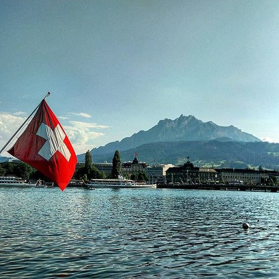 Just Gazing at Marvels , day in and day out... Nofilter Lakeluzern Luzern Lake Flag Swissflag Lovethiscountry Cantgetenoughofthiscountry Mountain Laketown CH HTCDesireEye