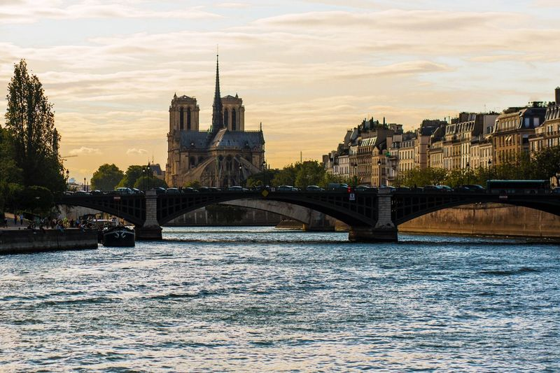 Your Ticket To Europe Architecture Bridge - Man Made Structure River Building Exterior Sky City Transportation Outdoors No People Travel Destinations Cityscape Paris River Seine Church Church Tower Lost In The Landscape An Eye For Travel Colour Your Horizn