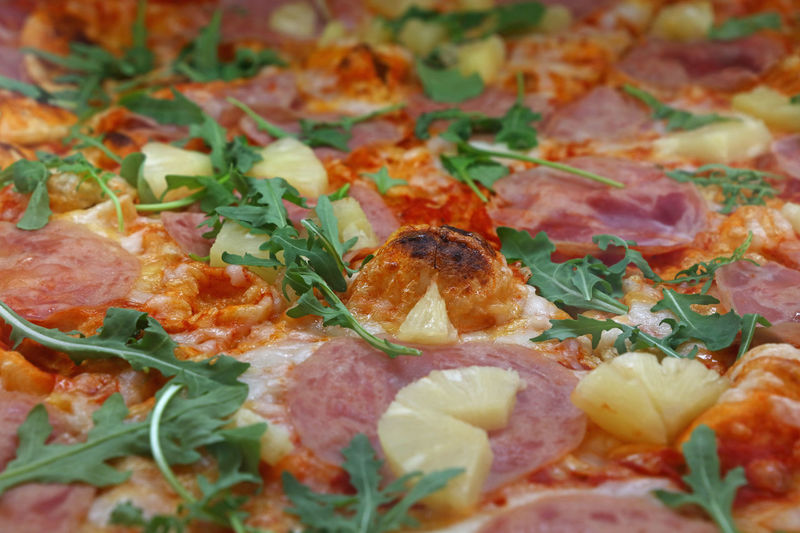 Close up of big Italian pizza with pinapple, personal perspective Cooking Cuisine Fast Food Pineapple Arugula Backgrounds Close-up Food Food And Drink Freshness Full Frame Hawaian Italian Food Leaf Meat Personal Perspective Pizza Ready-to-eat Salami Traditional