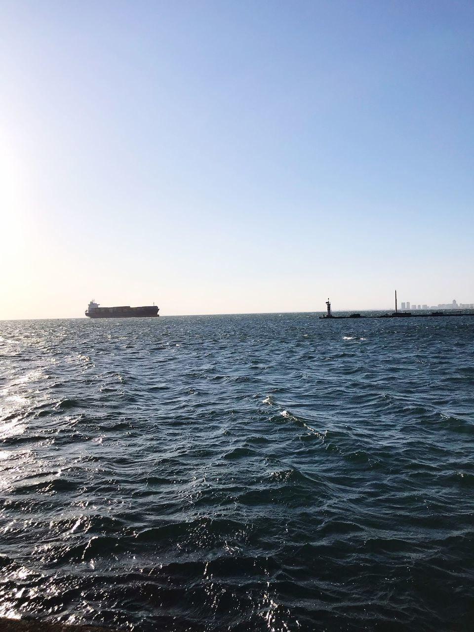 sea, sky, water, scenics - nature, clear sky, beauty in nature, waterfront, tranquil scene, nature, copy space, nautical vessel, tranquility, horizon, horizon over water, rippled, no people, transportation, blue, day, outdoors, sailboat