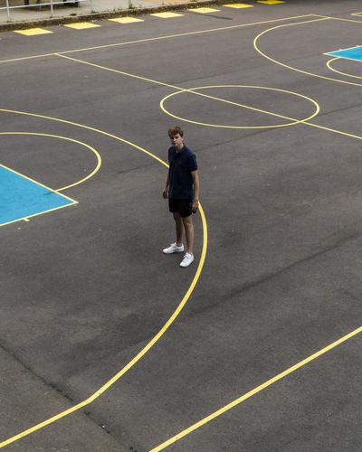 High angle view of man standing on basketball court