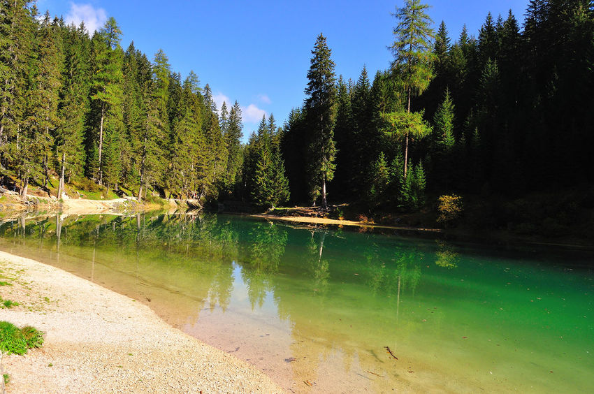 Alps Green Color Harvest Season Lake Mountain Nature No People Outdoors Reflections Sea Touristic Destination Tranquility Water Yellow Color