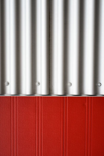 Abstract detail of an urban construction, red and grey. Abstract Abstract Backgrounds Abstract Photography Aluminum Architecture Brushed Metal Close-up Construction Day Detail Detailphotography Industry Metal Minimalism Minimalist No People Red Shiny Silver - Metal Silver Colored Stainless Steel  Steel Textured  Urban Urban Construction