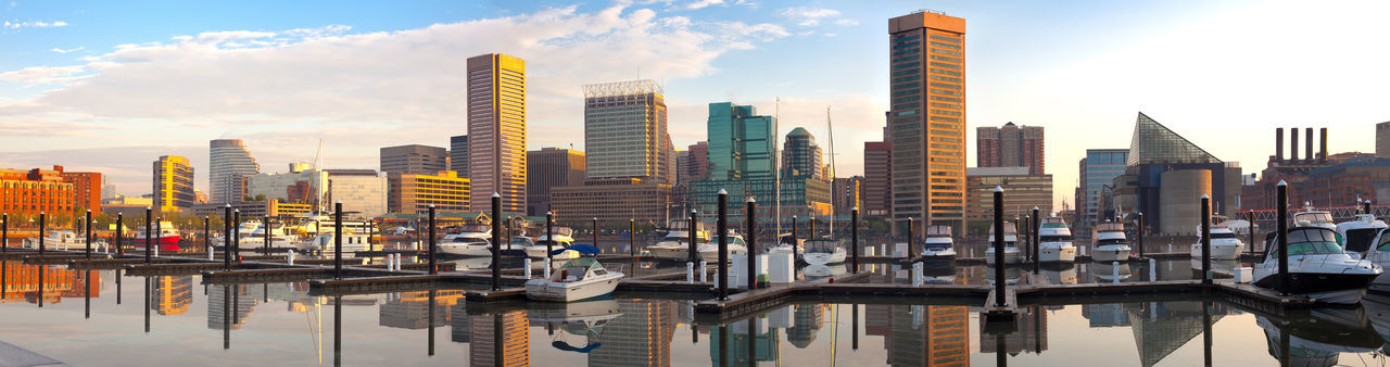 Downtown city skyline, Inner Harbor and marina, Baltimore, Maryland, USA Architecture Baltimore City Cityscape Inner Harbor Marina Maryland Reflection Skyline USA Boats Buildings Dawn Sunrise