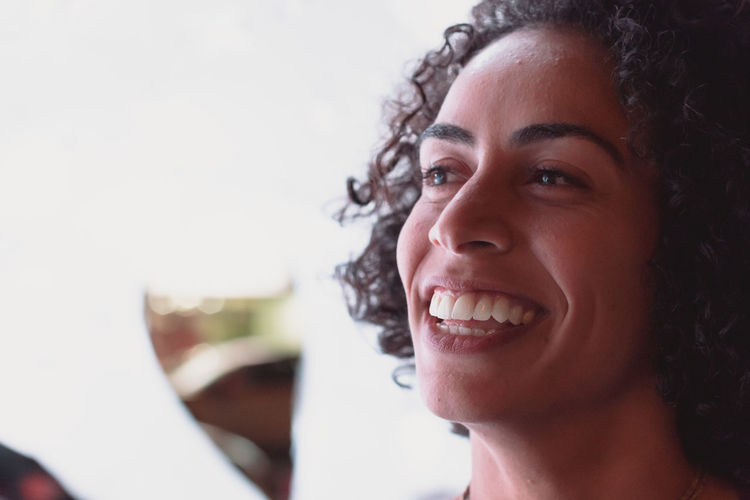 Looking Away Focus On Foreground Leisure Activity Close-up Young Adult Happiness Lifestyles One Person Curly Hair Portrait Headshot Toothy Smile Smiling Real People Teeth Hair Emotion Hairstyle Human Face Moments Of Happiness