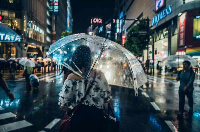Shibuyascapes ◀️☔️🚶‍♀️🌃🇯🇵 Walk This Way New Vintage EyeEm Best Shots Japan On The Way Raindrops Rainy Days Romantic Tokyo Women Who Inspire You Atmospheric Mood City Street Fragility Illuminated Lifestyles Night People Rain Rainy Season Rear View Street Umbrella Weather Women Around The World The Week On EyeEm HUAWEI Photo Award: After Dark Urban Fashion Jungle