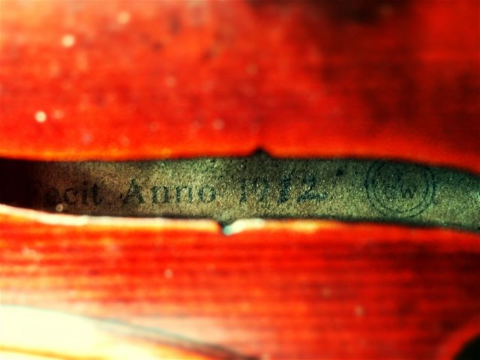Embrace Urban Life Violins Violinists Red Textured  Indoors  Violin Practice Close-up No People Day Freshness