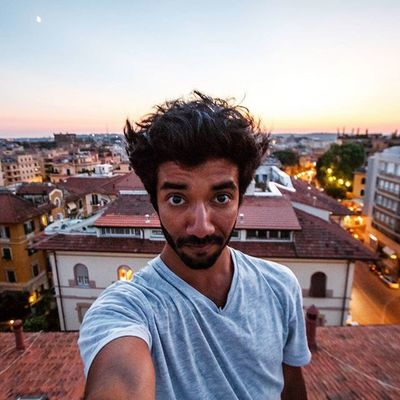 Chilling on a rooftop in the middle of Rome at sunset. Something you can only do with a local. Ventoura Europe Travel Rooftop Sunset rome roma italy italia explore adventure livelaughexplore standingontheedge nearlyfell butdidnt