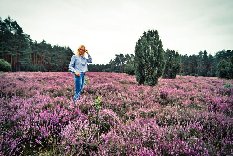 Full length of woman standing on heathland