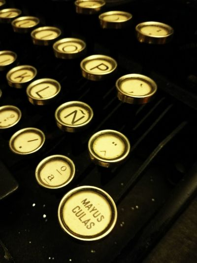 Old-fashioned Retro Styled Typewriter Antique Communication Metal Close-up High Angle View Alphabet Technology Text Built Structure keys buttons typewriter invention Alphabet Letters Spanish Keys