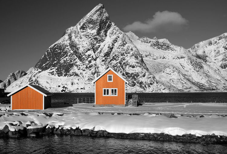 Lofoten Islands, Norway Norway Paint The Town Yellow Winter Architecture Beauty In Nature Building Exterior Built Structure Cold Temperature Day House Lofoten Mountain Mountain Range Nature No People Outdoors Scenics Sky Snow Tranquility Water Winter Yellow