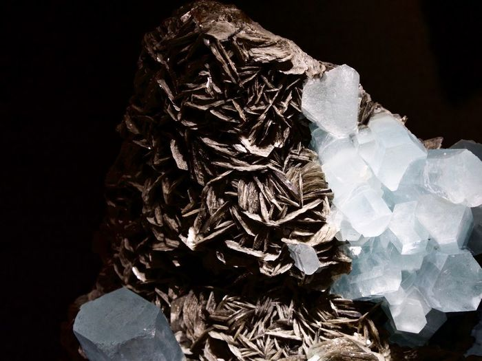 Black Background Indoors  Studio Shot No People Mineral Close-up Crystal White Color Paper Geology Still Life Nature Pattern Solid Rock Rock - Object Single Object Bag Beauty In Nature Natural Condition Aggression  Quartz