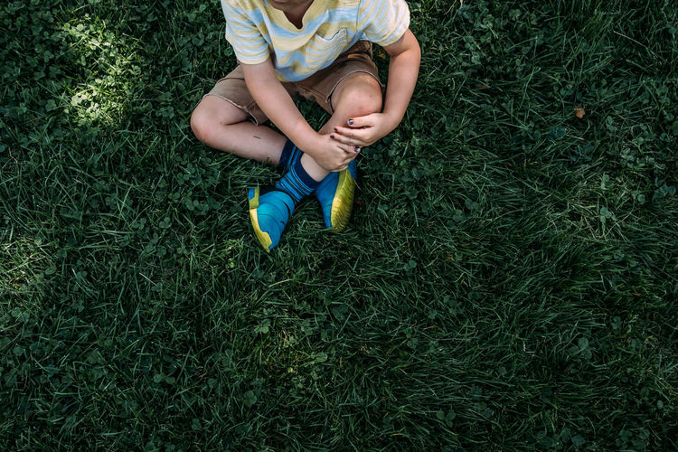 Low section of child on field