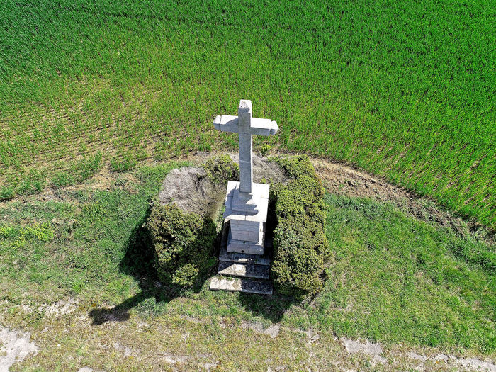 Aerial photo of a stone calvary in Vendee, France Stone Calvary Vendée France Environment Grave Cross Christianity Christian Religion Sunlight Day Nature Plant Field Grass Land No People Green Color Aerial View Aerial Photography Symbol