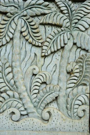Indonesia, Bali, Ubud, Agung Rai Museum of Art - ARMA -, vertical reliefs of nature, palm trees Agung Rai Museum Architecture Arts And Crafts ASIA Bali, Indonesia Bas-relief Close-up Culture Day INDONESIA Nature Motif No People Palm Tree Ubud, Bali Vertical