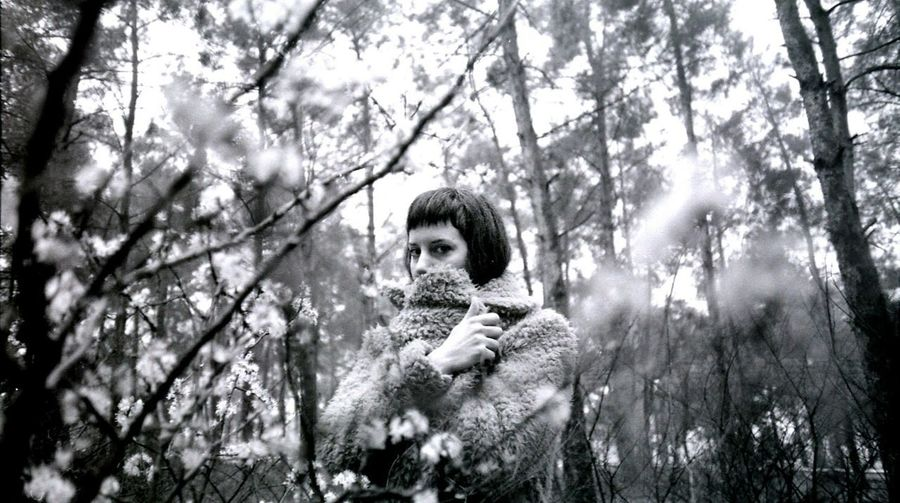 Portrait of woman in forest