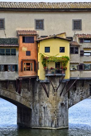 Ponte Vecchio Architecture Building Exterior Built Structure Outdoors Day Window No People Residential Building Water Been There. Italy Visit Italy City Florence Travel Destinations The Best City In The World Historical Building History Struts SUPPORT Window Boxes Potted Plants In Sun Shapes And Forms Window Grill Paint The Town Yellow The Week On EyeEm Connected By Travel