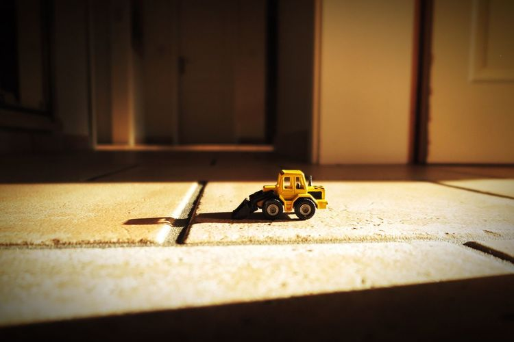 Toy earth mover on floor at home