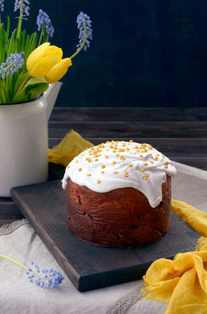 Traditional Russian Easter cake and spring flowers Easter Food And Drink Frosting Holiday Homemade Russia Cake Close-up Easter Cake Flower Flowers Food Food And Drink Food Photography Foodphotography Freshness Kulich No People Ready-to-eat Spring Sweet Food Table Vase Wood - Material Yellow