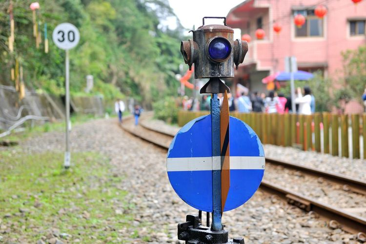 Railway traffic signs Attention Caveat Light Sign Traffic Signs Transportation Close-up Communication Concerned Day Direction Flashing Lights Focus On Foreground Happening No People Note Outdoors Railroad Track Railway Railway Signal Road Sign Status Transportation