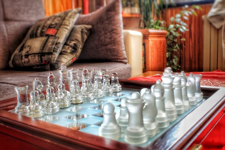 Full frame shot of chess pieces on table at home