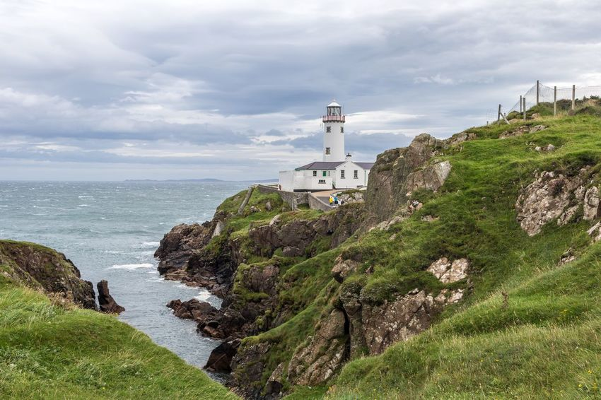 Fanad Lighthouse, Donegal, Ireland Donegal Fanad Lighthouse, Donega Ireland Beauty In Nature Cliff Cloud - Sky Horizon Over Water Lighthouse Nature Outdoors Scenics Sea