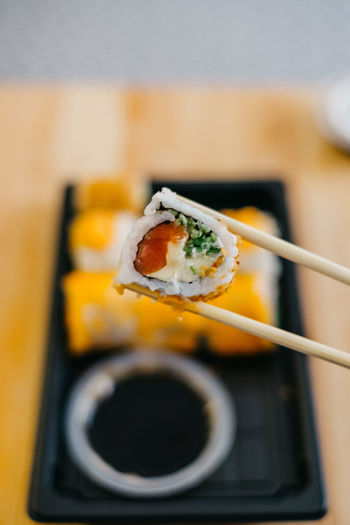 Sushi chopstick california roll bambu Food And Drink Food Freshness Japanese Food Wellbeing Ready-to-eat Indoors  Close-up No People Sushi Bambu Natural Light Sunlight Soy Sauce Avocado California Roll Rollercoaster Sushi Rolls Sesame Rice Paddy Salmon Fish Sea Food Japanese Culture